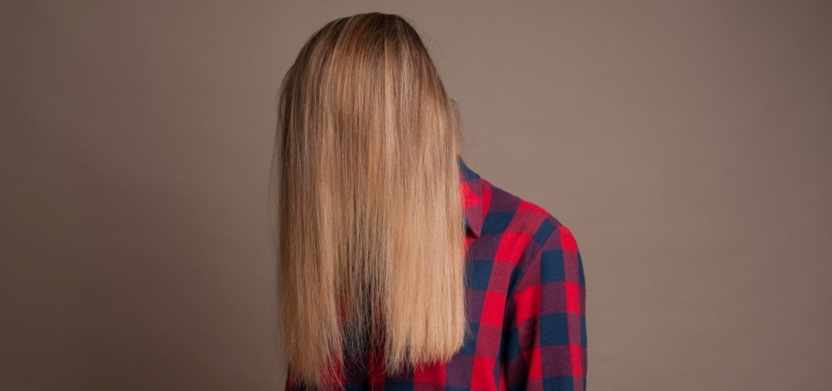 woman's face covered by her hair