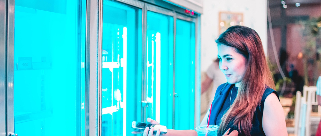 woman browsing commercial refrigerator
