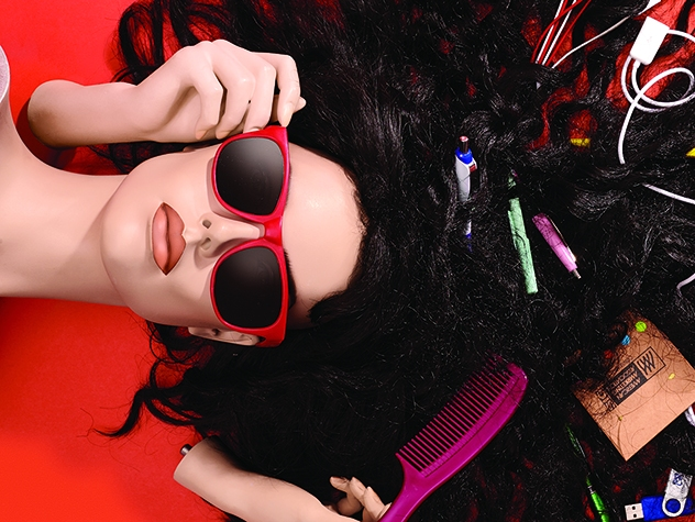 female mannequin head with loose odds and ends strewn throughout her hair