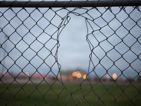 hole in chain link fence