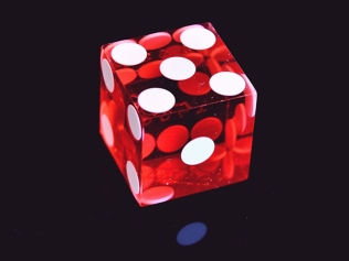 red six-sided die displaying 5