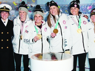 USA Hockey players holding Olympic medals