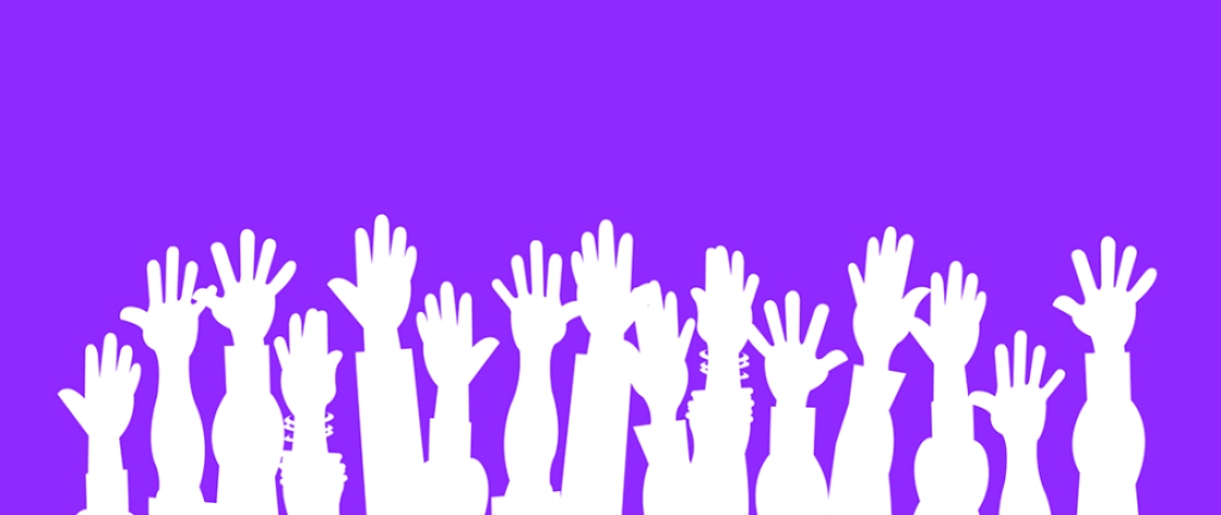 white hands reaching up against purple background