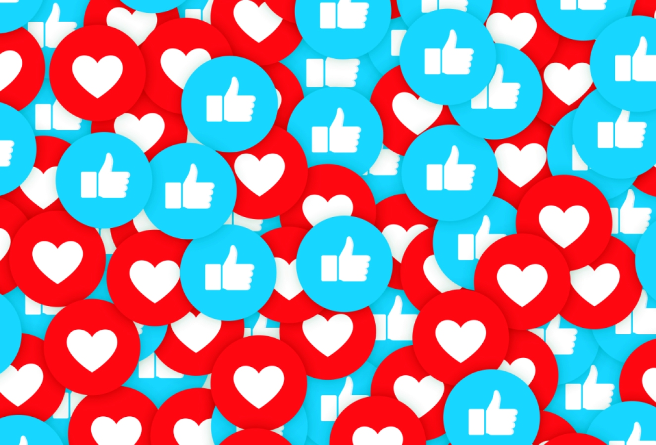 repeating pattern of blue thumbs up circles and red heart circles