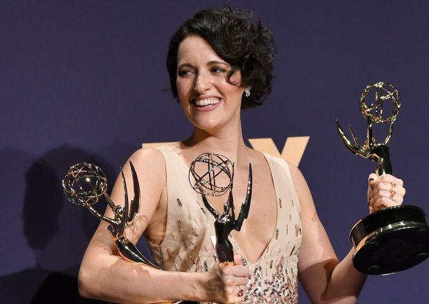 Phoebe Waller Bridge holding her Emmys