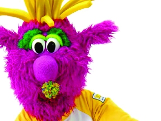 Reggy, purple fur mascot with yellow fry hair and green eyes