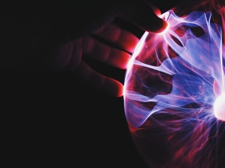 hand holding purple and red plasma ball