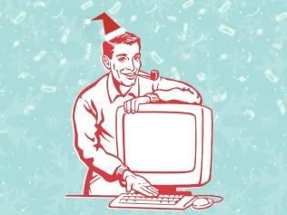man in santa hat at computer