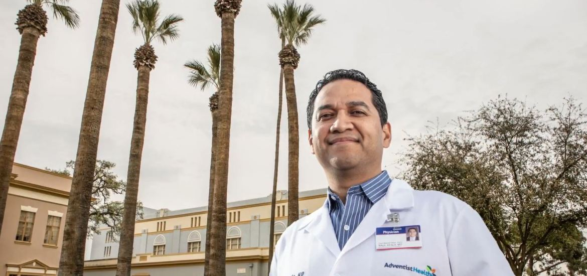photo of doctor outdoors in front of palm trees
