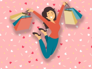 happy jumping woman holding shopping backs against pink background with hearts