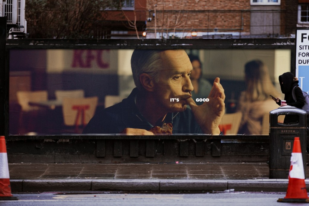 photo of KFC's finger lickin' campaign poster on street