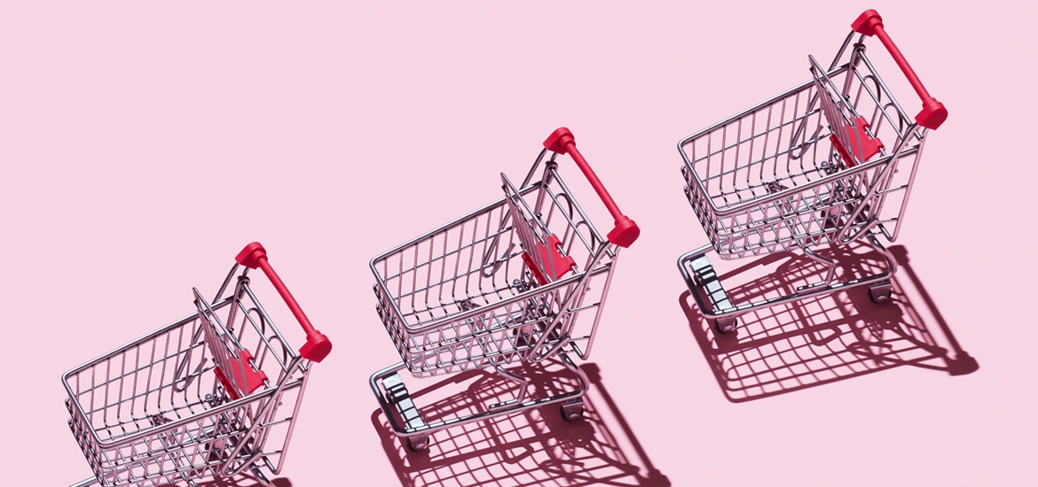 shopping carts on pink background