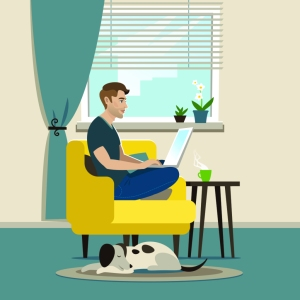 man working on laptop with sleeping dog next to him on floor