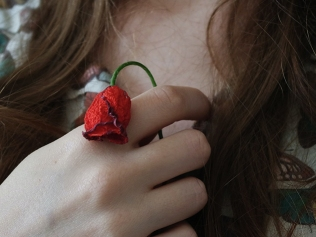 woman holding wilted rose