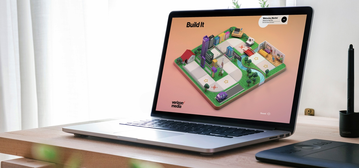 laptop with Build It Verizon Media game on screen