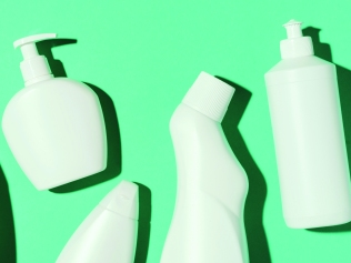 row of spray and soap bottles