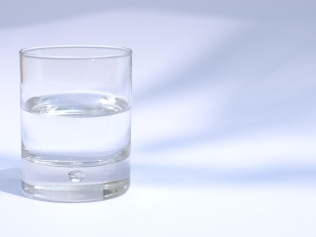 half-filled glass of water