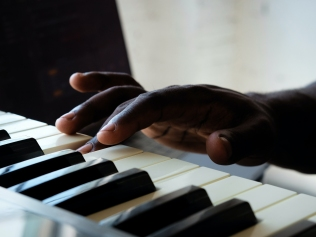 person playing piano key