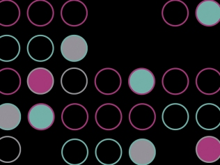 multicolored dots against black background