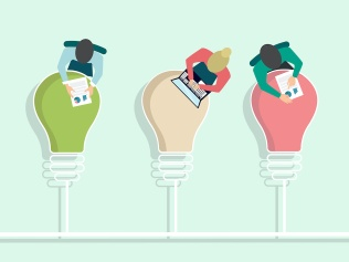five people working atop five lightbulbs