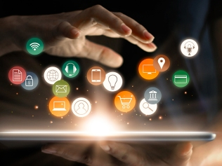 woman holding tablet with floating digital marketing icons