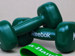 Green exercise weights with promotional branding on them